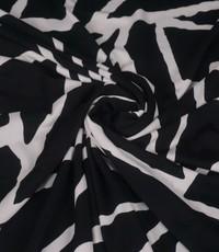 Travelstof in zwart witte driehoeken