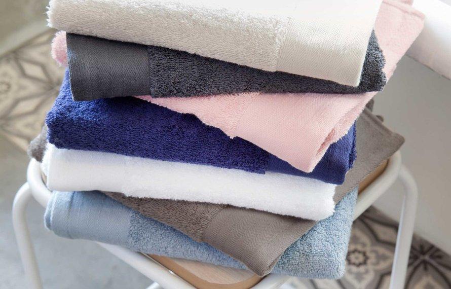 Wat kan ik doen tegen pluizende handdoeken?
