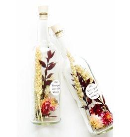 Mookstories Mookstories: Droogbloemen in een fles met bloemzaadjes