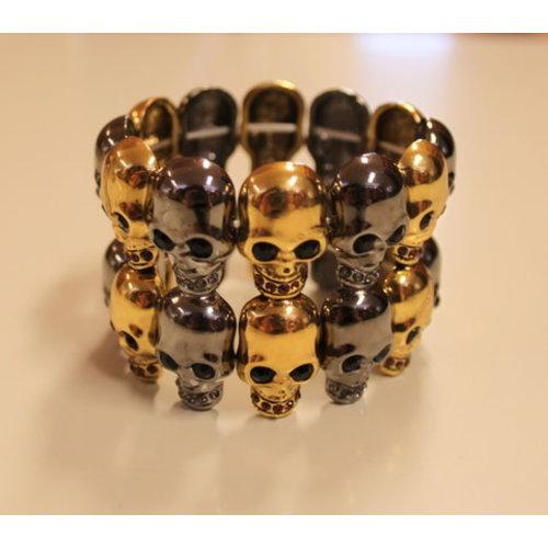 Armband doodshoofden zwart/goud