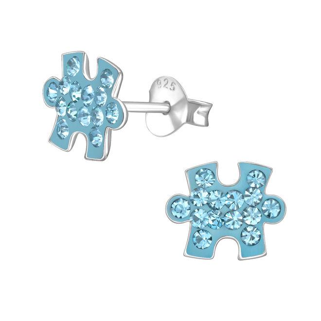 Zilveren kinderoorbellen: Puzzelstukje met kristallen steentjes