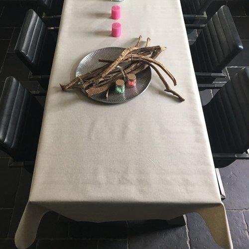 Coated table linen cream