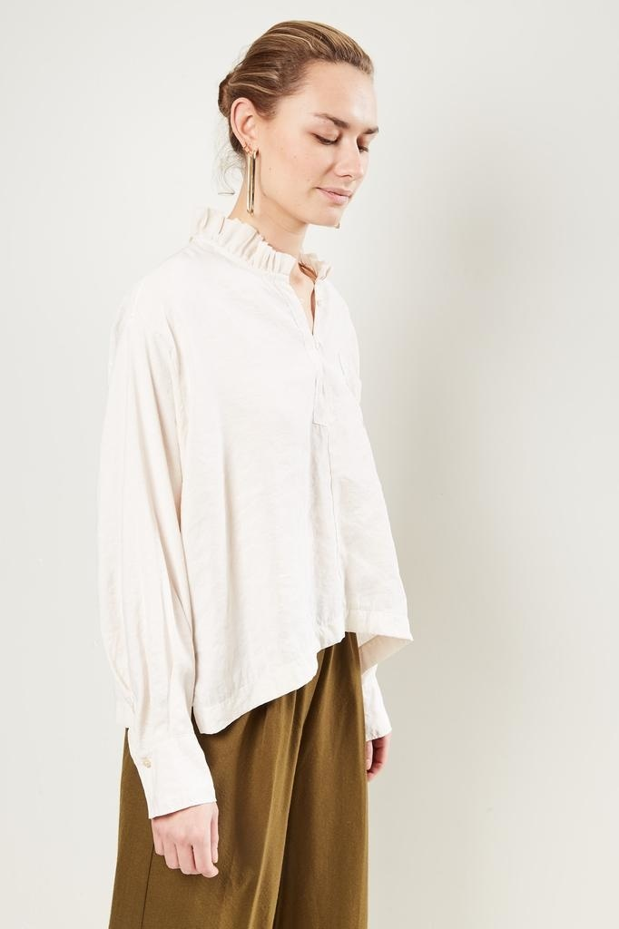 Forte Forte Ruffle trimmed half buttoned shirt.