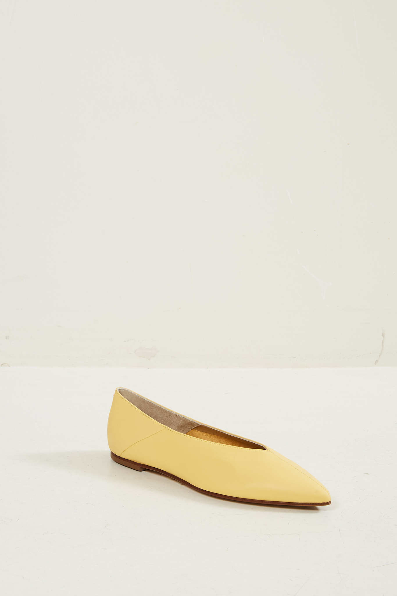 Aeyde Moa Pale Yellow ballerina shoes.