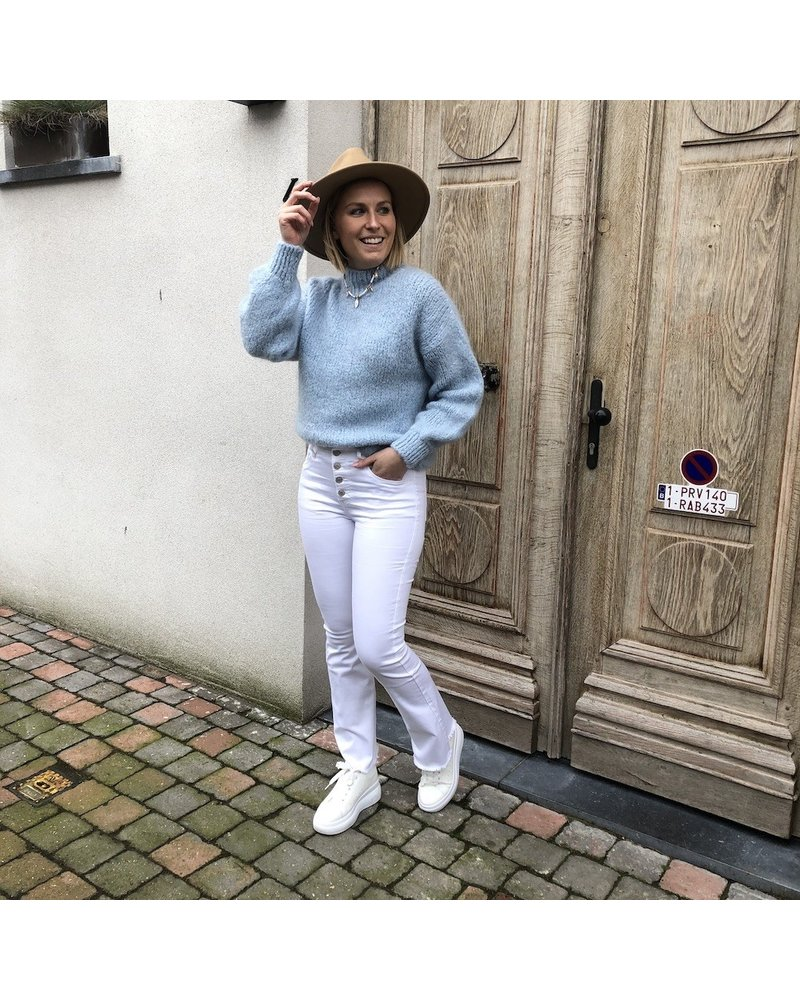 White flared jeans