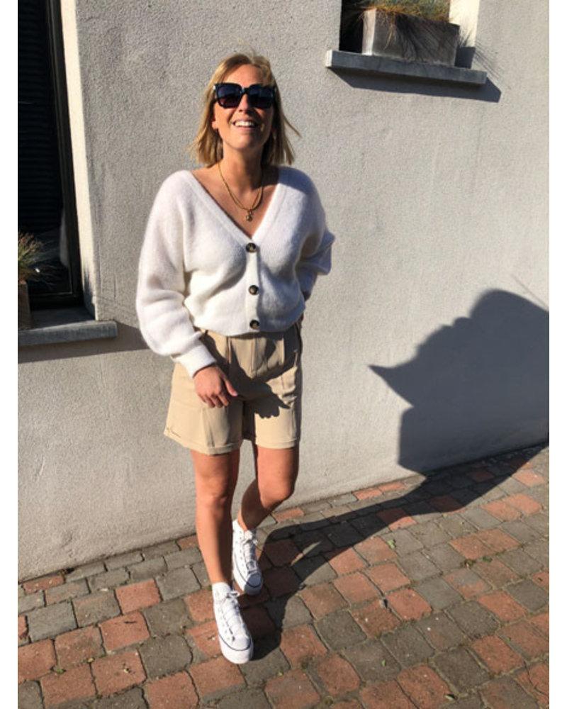 Beige shorts with belt
