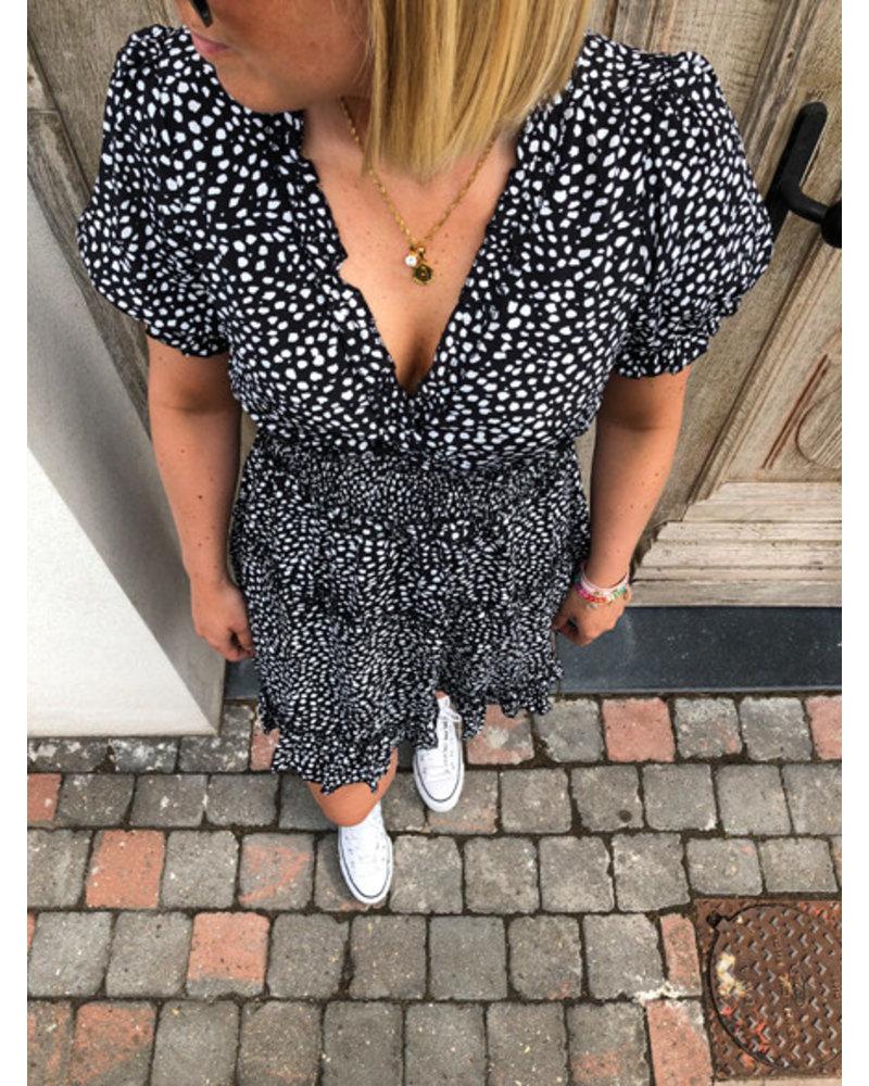 Black dotted dress