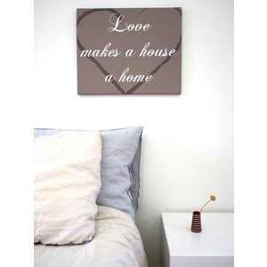 Tekst op canvas Love makes a house a home