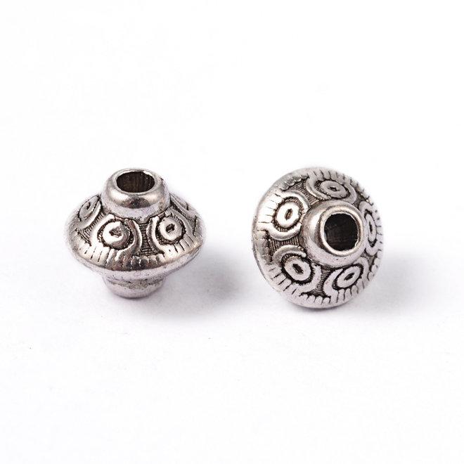 Metallperle im tibetischen Stil 7 x 6,5 mm - Antiksilber