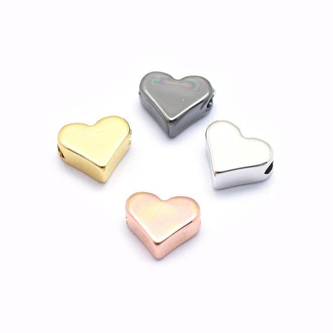 Perlina metallica a forma di cuore 6 x 7 mm