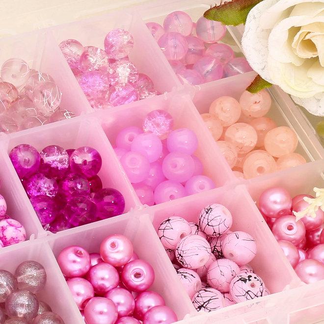 Box mit Sortiment von 24 runden Glasperlen 8 mm - Pink mix