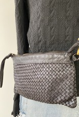 Little flexibel leather bag with woven front.