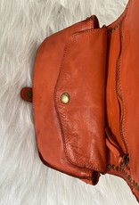 Flexible leather bag with studs