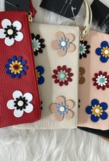 Little leather clutches in several colors with little flowers