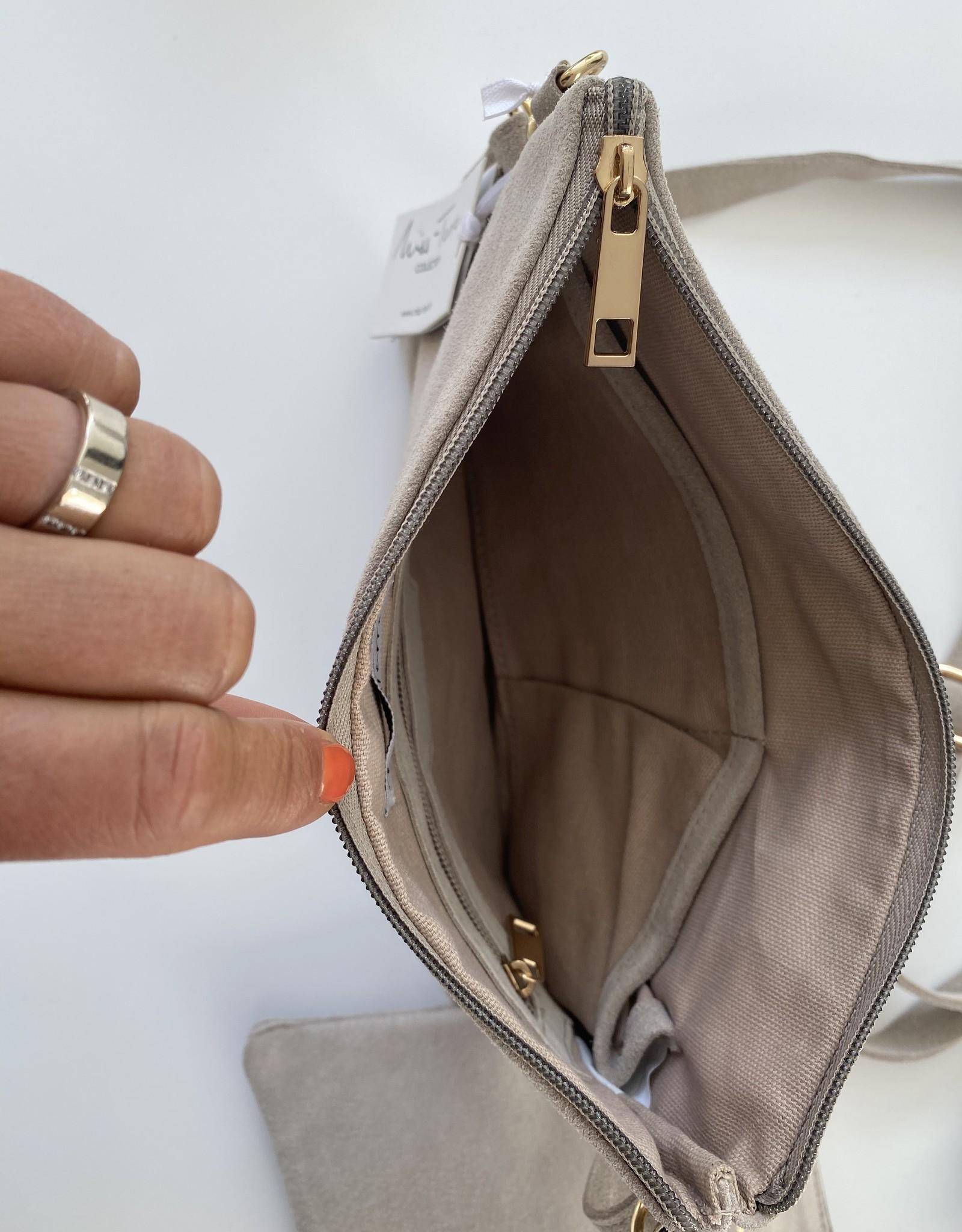 Clutch/bag with long shoulderbelt , natural daim color.
