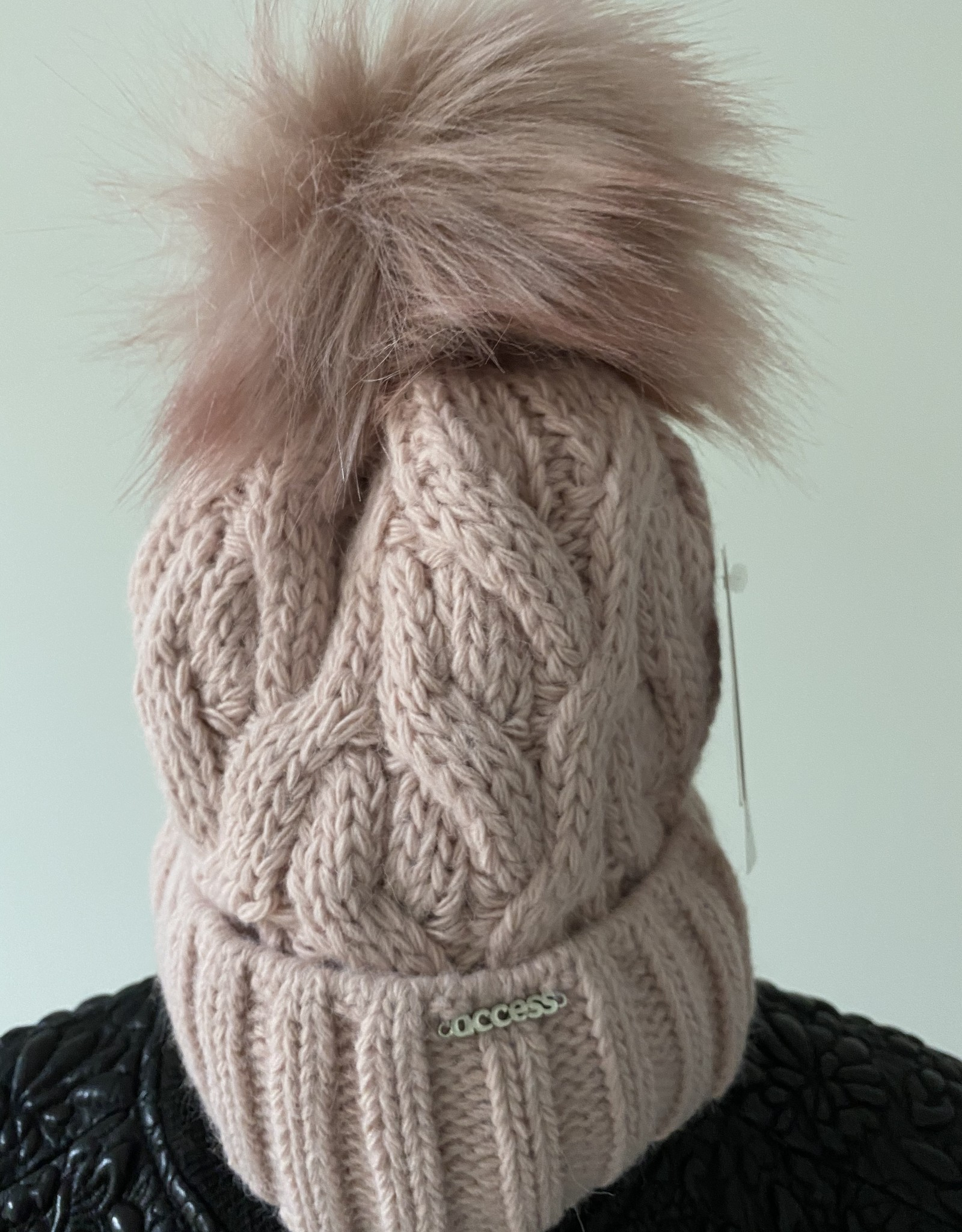 Knitted hats with pompon, with fleece inside.