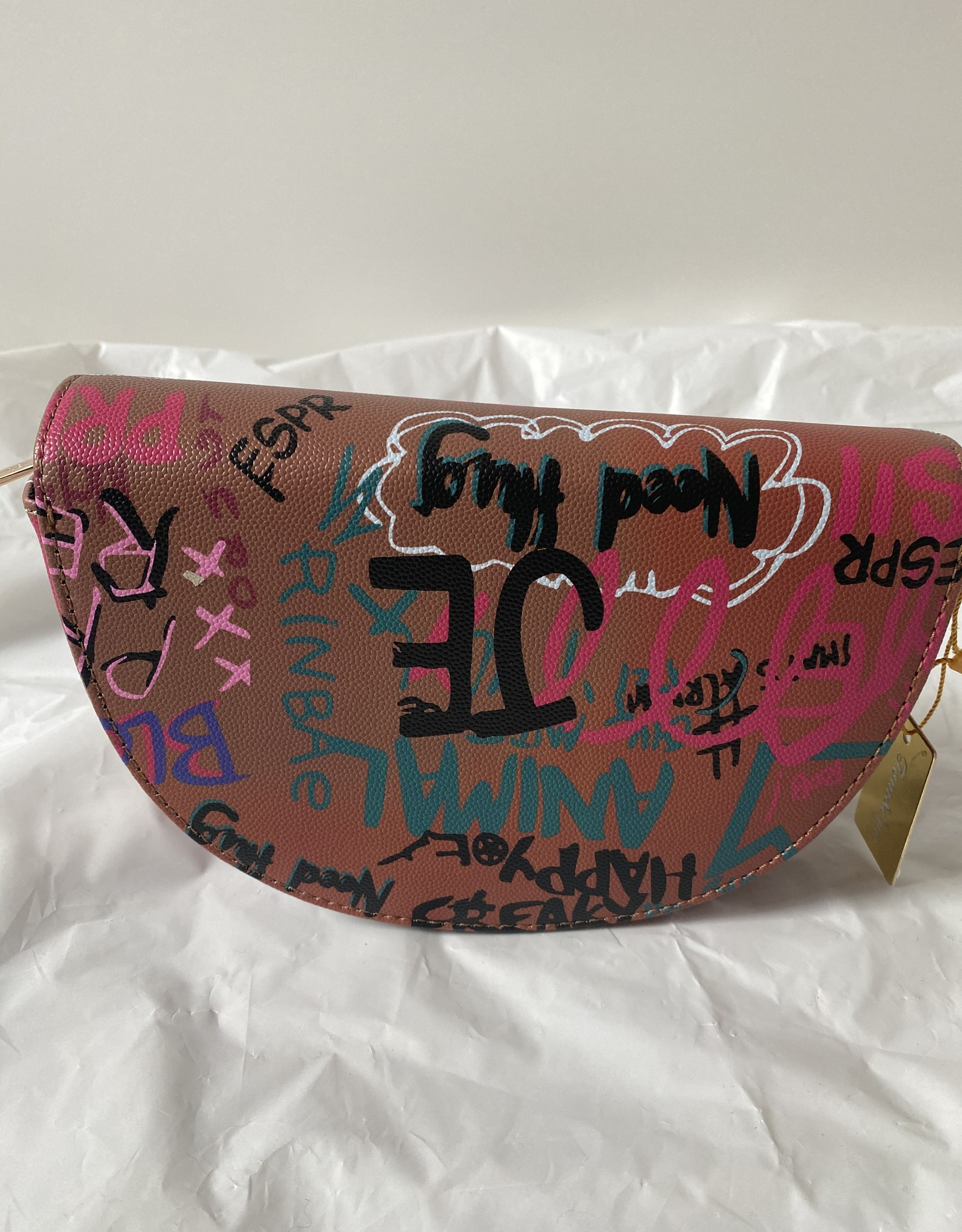 Half moon bag with graffiti.