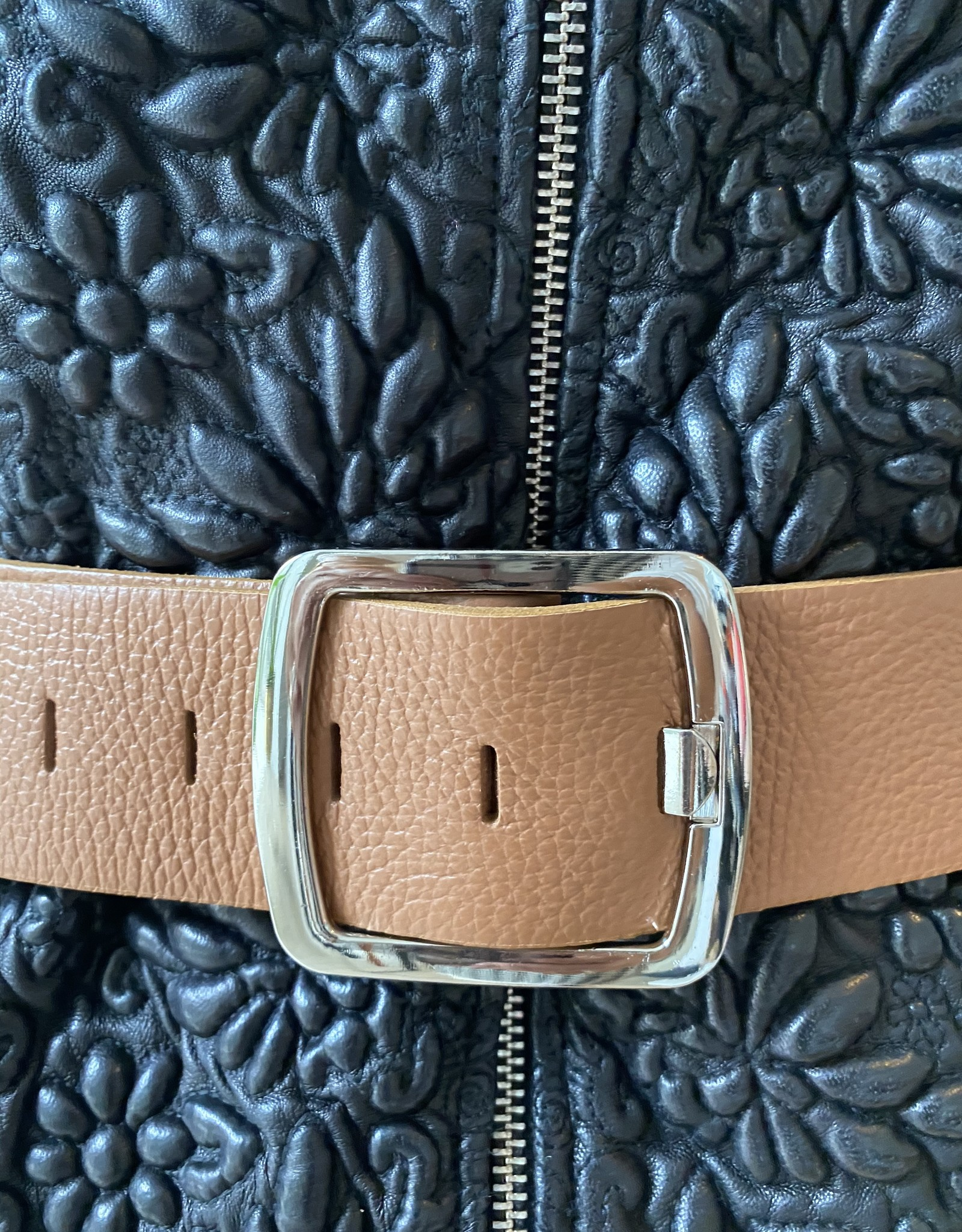 Wide leather belt with silver buckle.