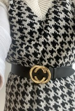 Leather belt with golden buckle with detail