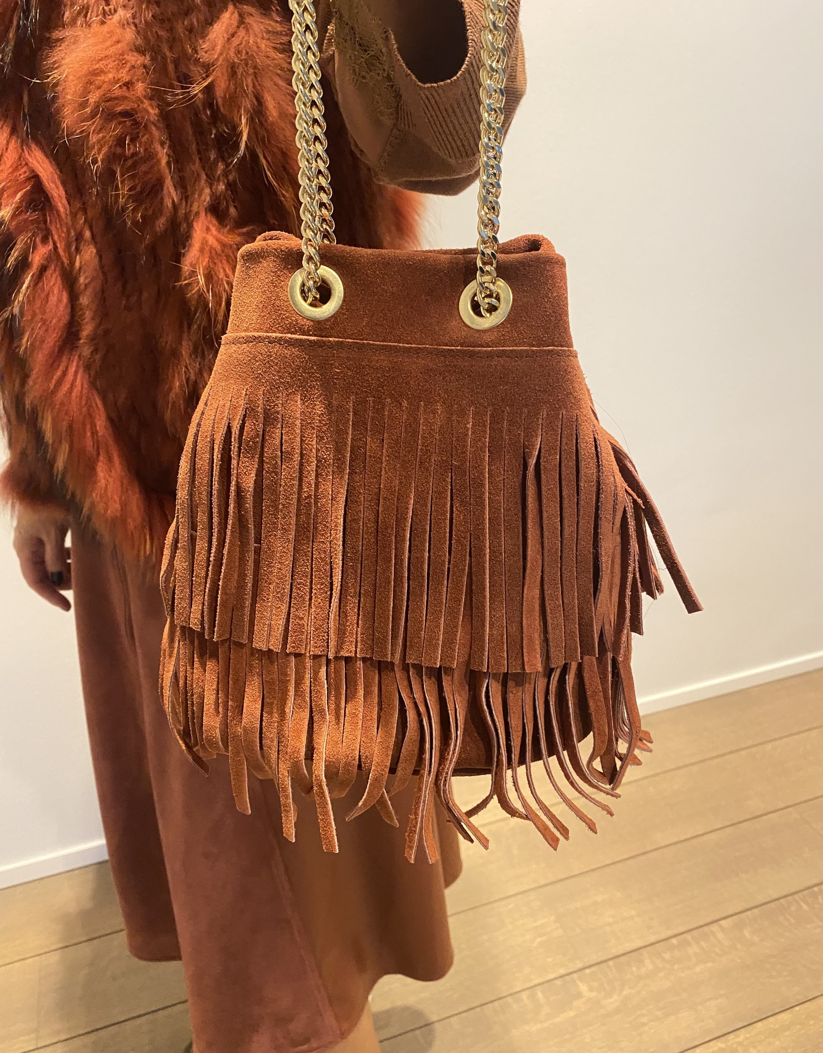 Rust buckskin pouch bag with chain belt with fringles.