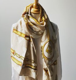 Long scarf with logo in beige colors.