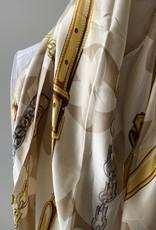Rechthoekige lange sjaal met logo in beige tinten.