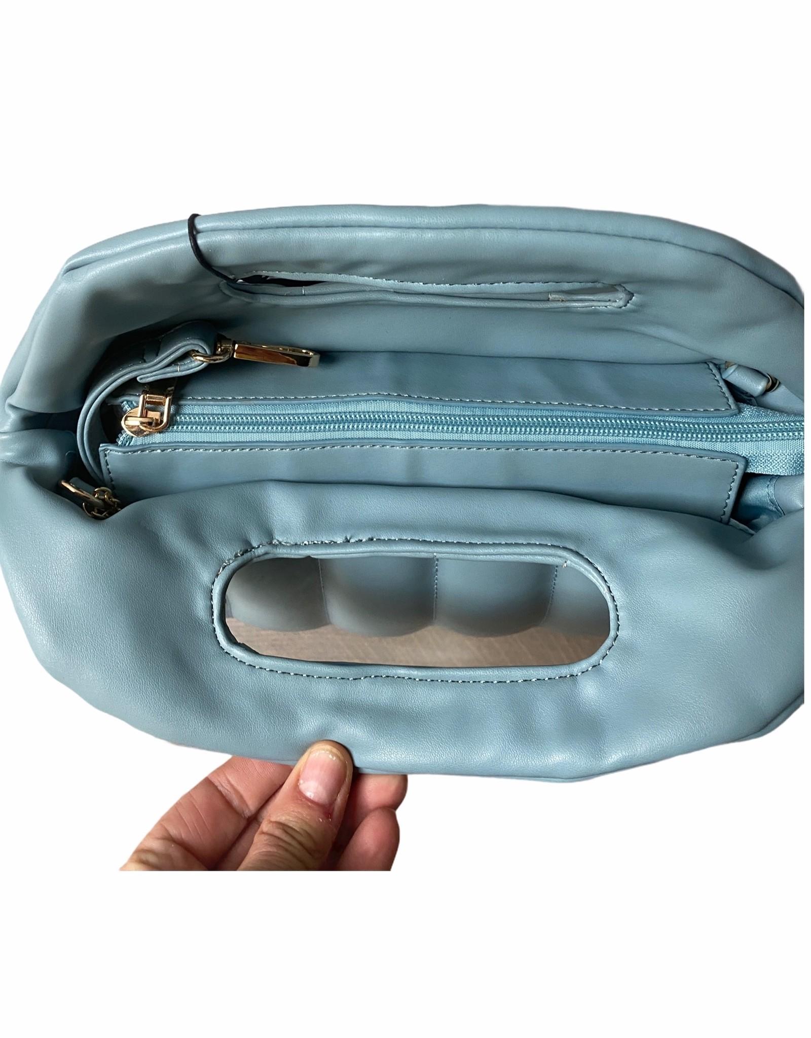 Kunstlederen blauwe handtas met lange schouderriem.