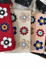 Kleine lederen clutches in vele kleuren met kleine lederen bloemen