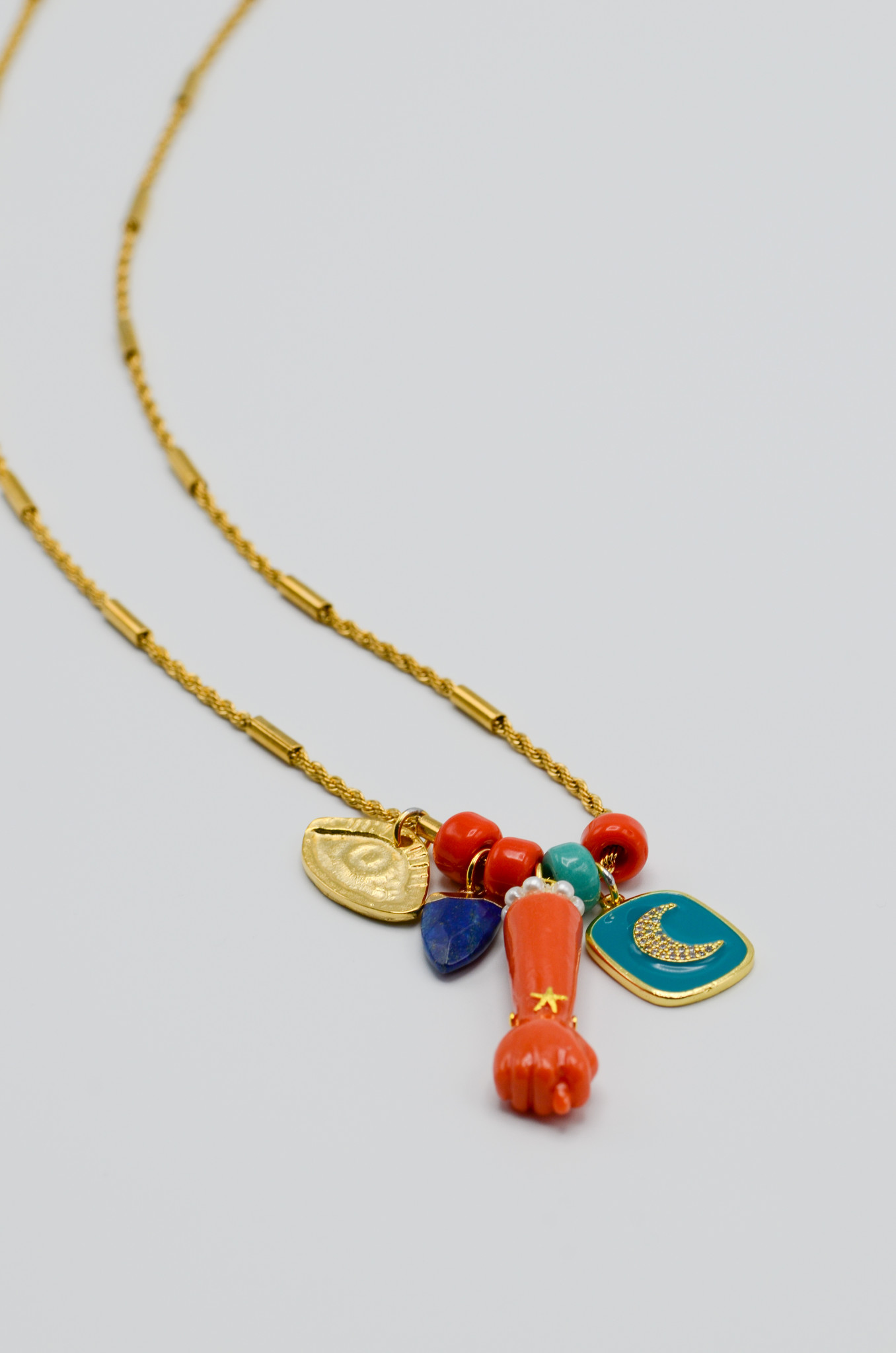 FIG HAND PENDANT IN CORAL-1