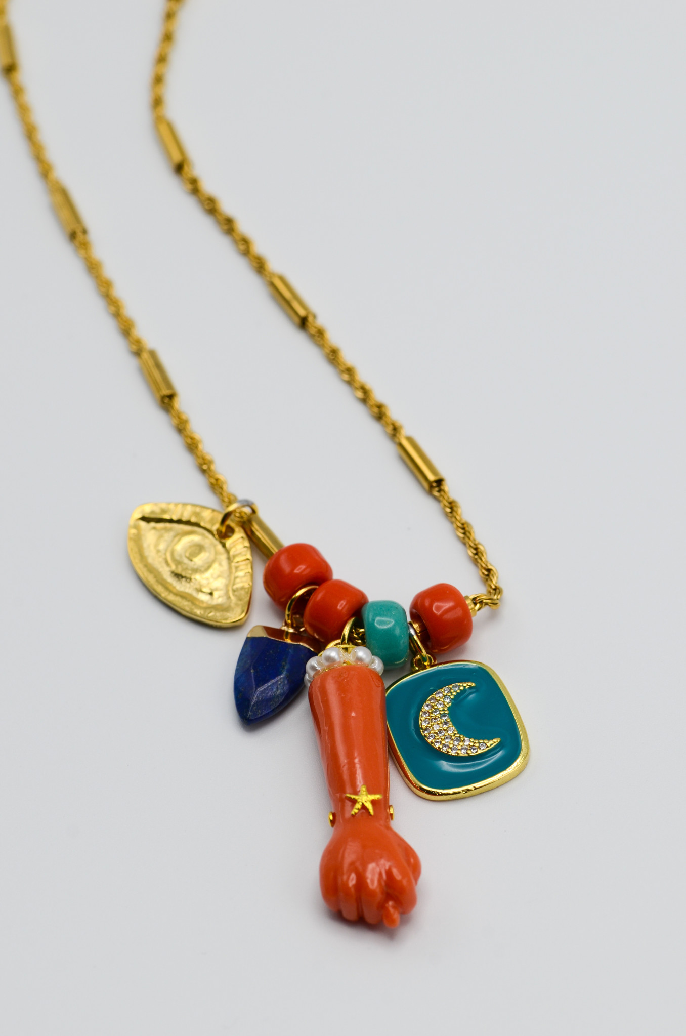 FIG HAND PENDANT IN CORAL-2