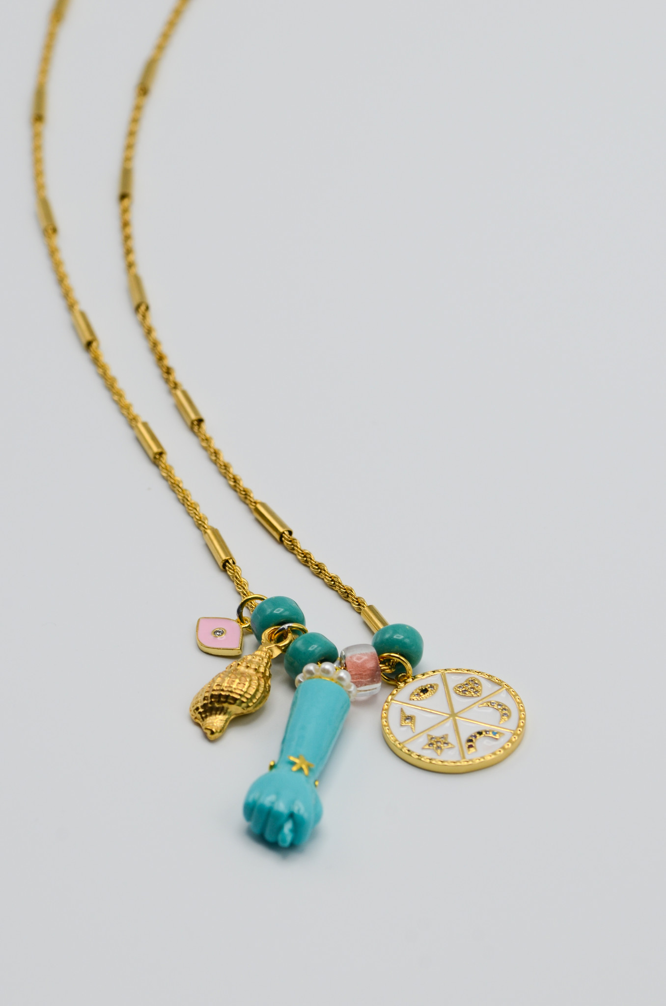 FIG HAND PENDANT IN TURQUOISE-1