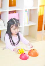 Plan Toys Plan Toys - KLEURRIJKE STAPELTOREN - KIPPENNEST