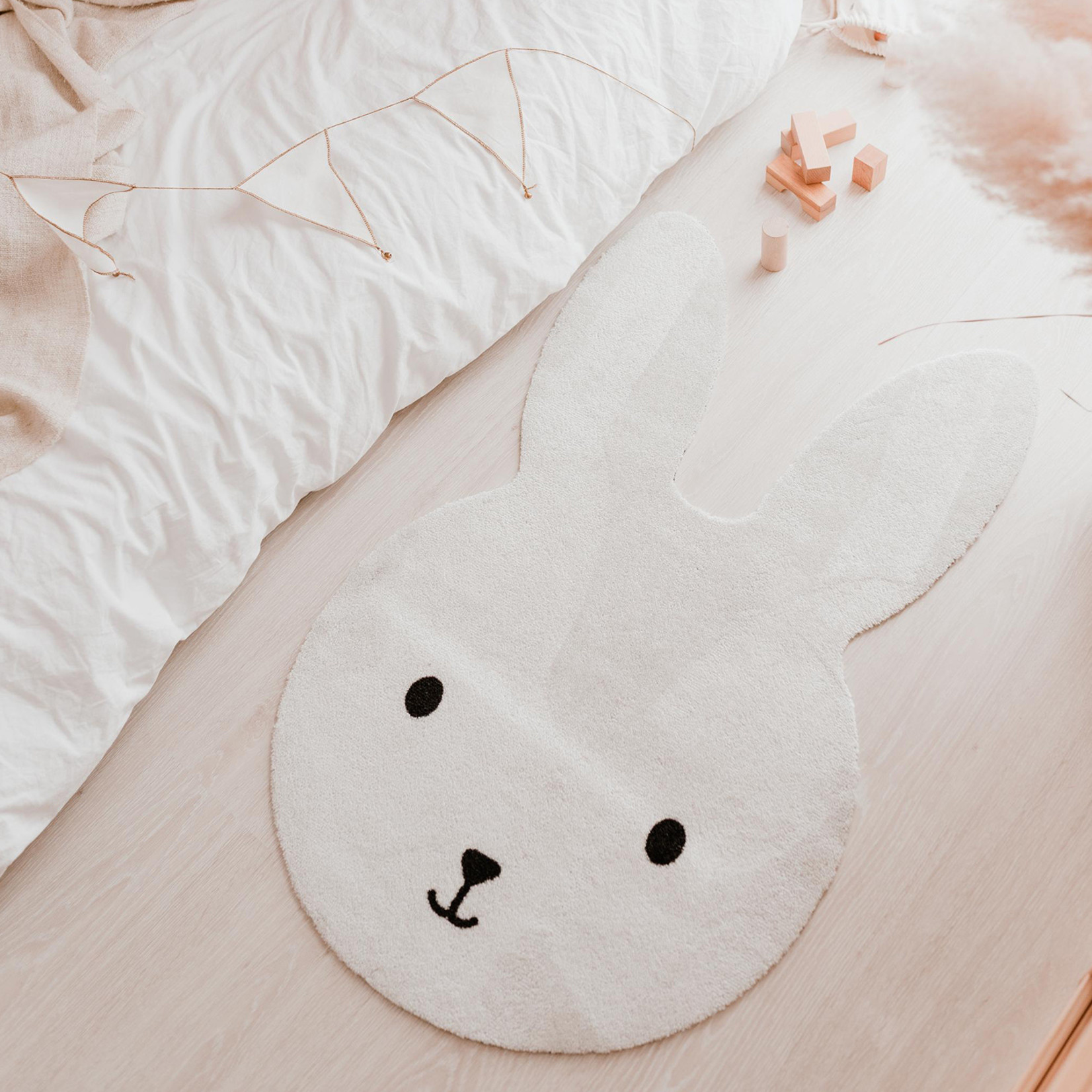 Eulenschnitt Teppich Hase