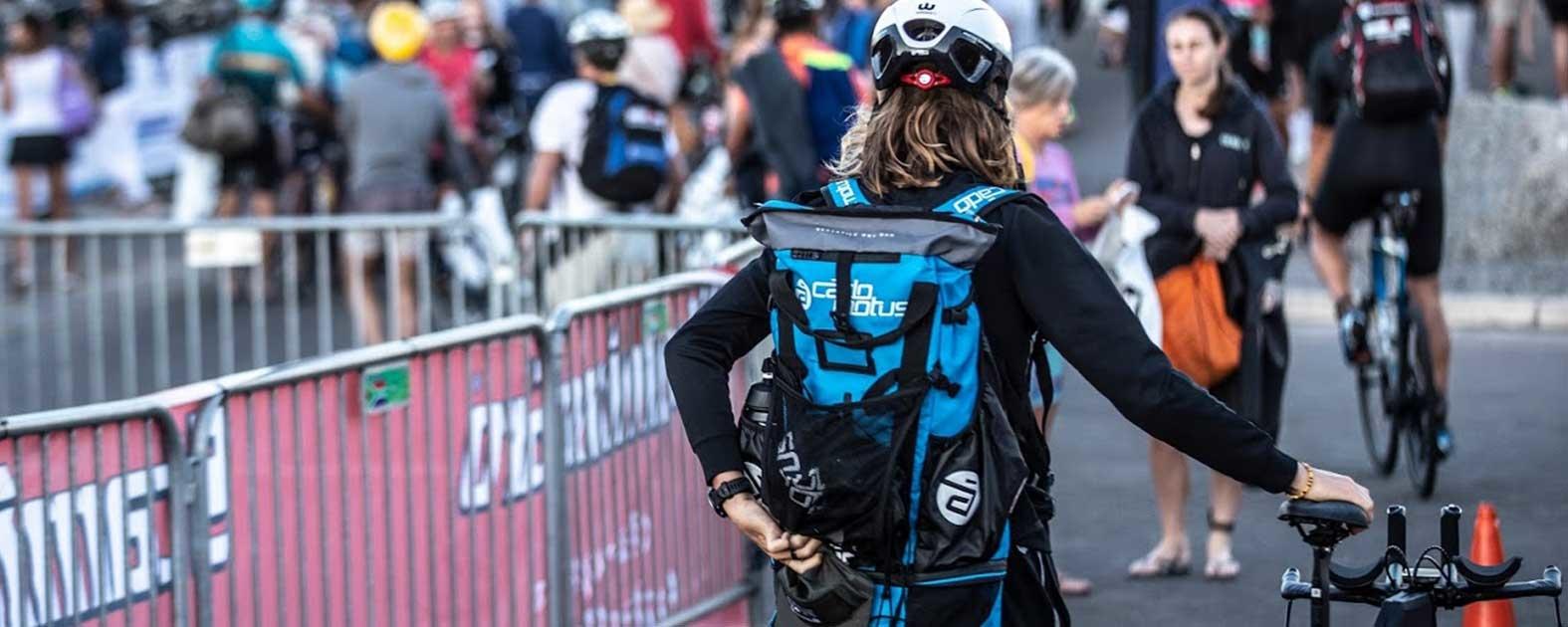 Jamie Riddle Pro Triathlete with Cadomotus helmet and backpack