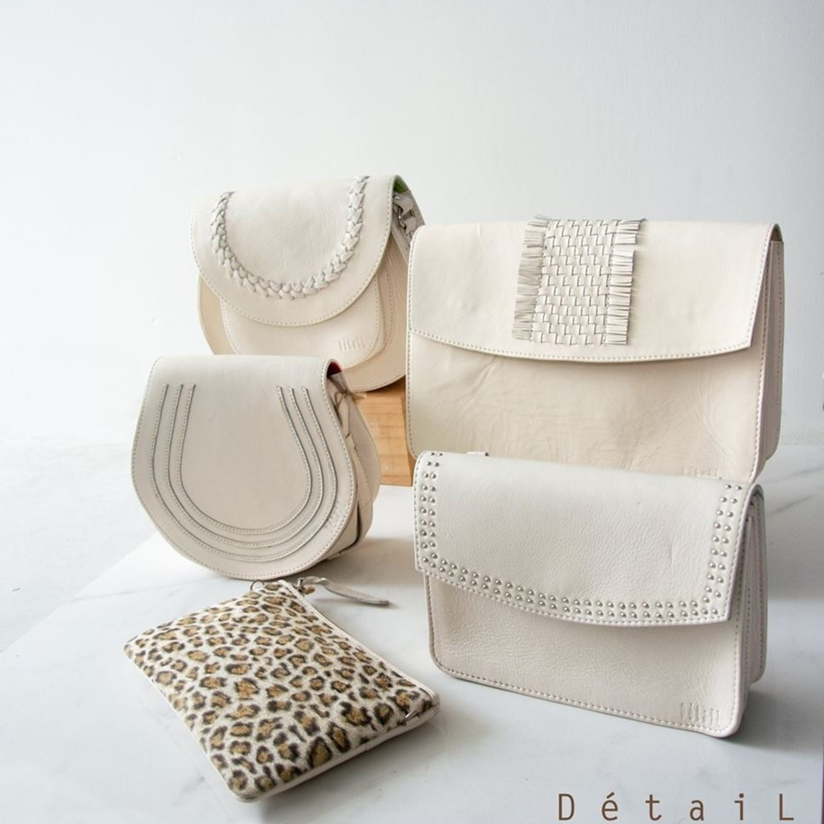 Détail Pure met studs - Off white
