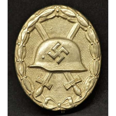 Wehrmacht wounded in combat badge  gold