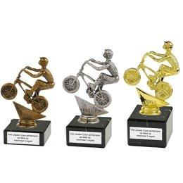 BMX figuur op marmer Goud_zilver_brons