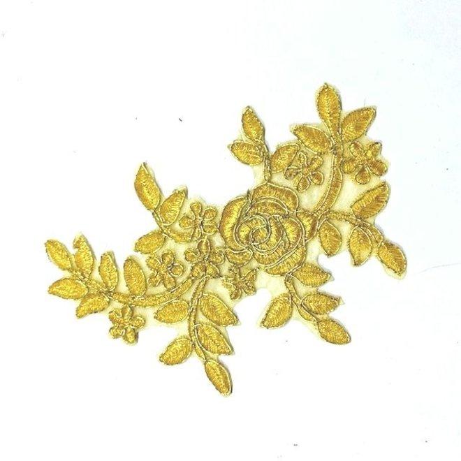 Spitzenapplikation in Gold