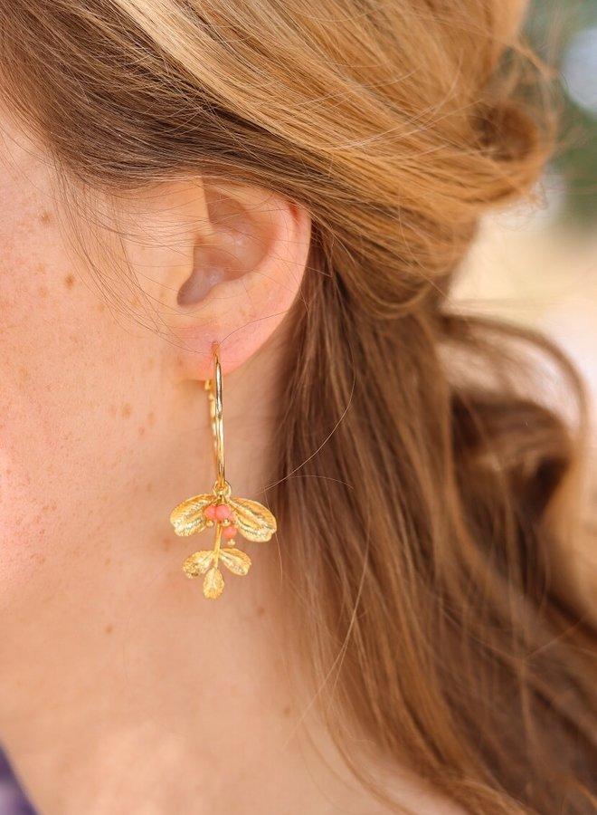 Asymmetrical hoop earrings with pink coral leafs
