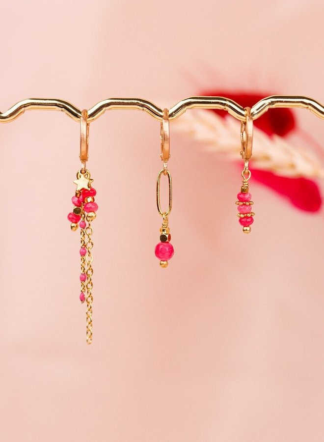 Three matching pink earrings with a tiny star