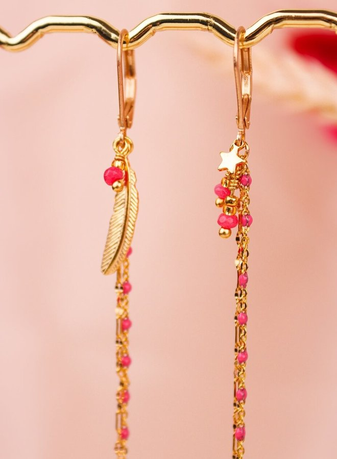 Matching asymmetrical pink feather and tiny star earrings