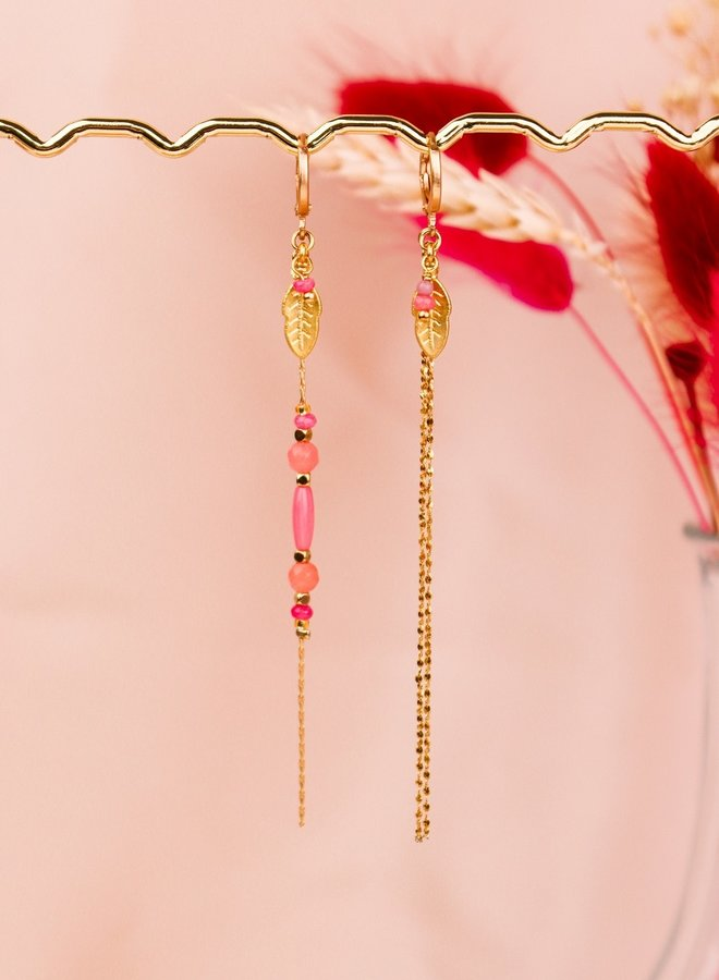 Matching asymmetrical pink feather earrings