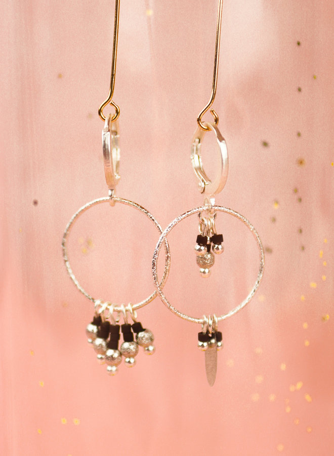 Asymmetrical silver hoop pair with dark blue miyuki