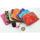 Geluksbuideltje met mini boeddha, muntje, steentje en gelukspoppetje