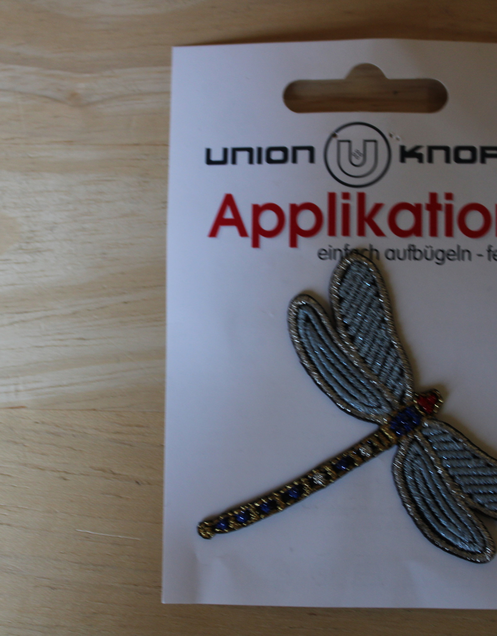 Union Knopf applicatie libel