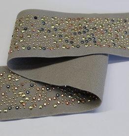Sier elastiek taupe met opliggende siersteentjes