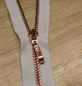 Fijne deelbare rits wit met metallic roségold 65cm