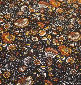 Viscose zwart bedrukt met retro oker bloemenprint