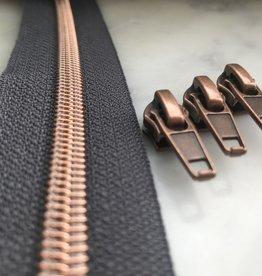1m metallic rits aan de meter 6mm : zwart met koper (incl. 3 schuivers)