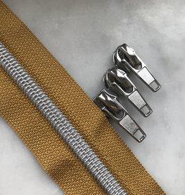 1m metallic rits aan de meter 6mm : oker met zilver (incl. 3 schuivers)